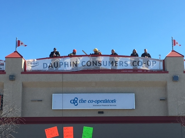 Members of the Dauphin Fire Department on top of the Dauphin Marketplace Mall